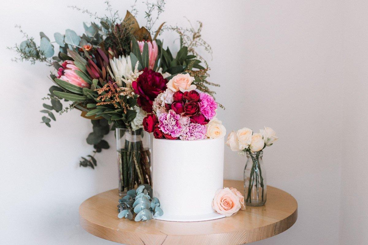 Karen Willis Holmes gown fern and stone Polka Dot Bride bouquet cake
