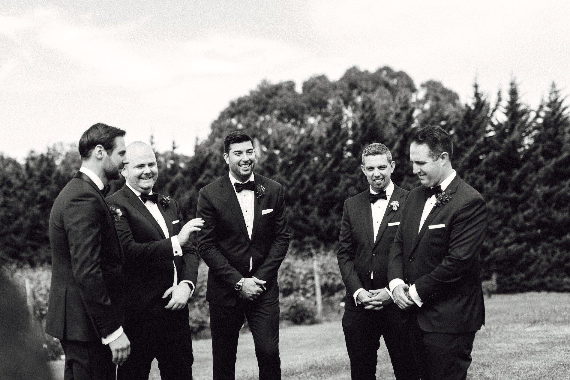 groomsmen before ceremony black and white